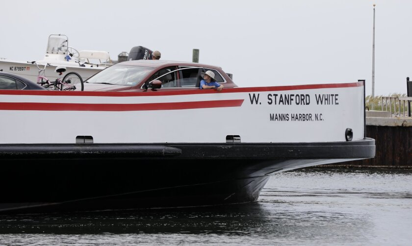 Passengers ride the ferry back from Ocracoke to Hatteras, N.C. Friday July, 28, 2017.