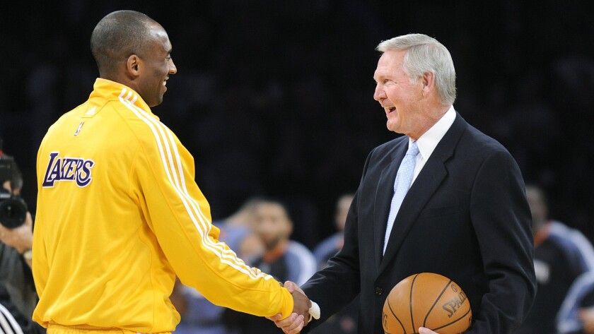 Kobe Bryant shakes hands with Jerry West in a 2010 ceremony to celebrate Bryant breaking the team record for most points.