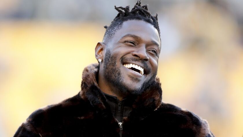 Pittsburgh Steelers wide receiver Antonio Brown stands along the sideline in street clothes before a