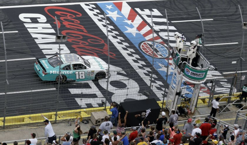 Denny Hamlin approaches the checkered flag to win the NASCAR Xfinity Series auto race at the Charlotte Motor Speedway in Concord, N.C., Saturday, May 28, 2016. (AP Photo/Gerry Broome)