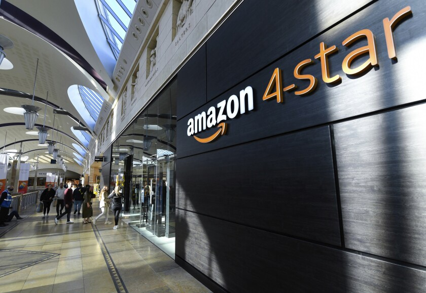 """A general view of the new Amazon 4-star store in Bluewater shopping centre, Kent, England, Wednesday, Oct. 6, 2021. Amazon has opened its first general store outside the United States in a mall in Britain, selling the online retail giant's most popular products including books, toys, games and consumer electronics. The U.S. company said the store, called """"4-star"""" because it sells products rated 4 stars or above by customers, reflects what customers are regularly buying and enjoying. (Doug Peters/PA via AP)"""