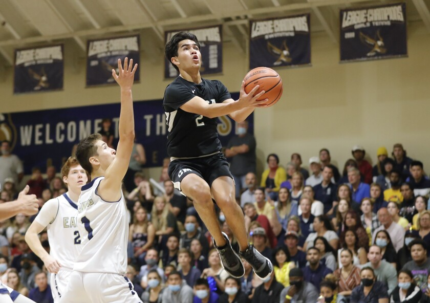 Aiden Spallone (2) of Costa Mesa lays it up and in during the CIF Southern Section Division 5AA final on Wednesday.