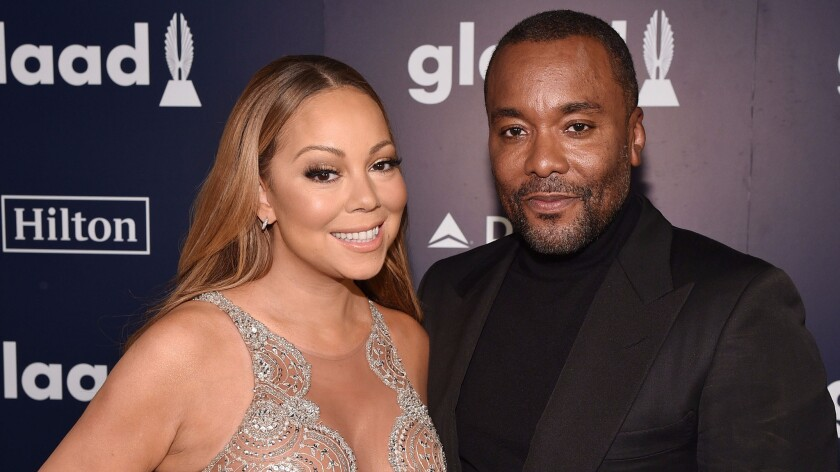 Mariah Carey, at this year's GLAAD Media Awards with Lee Daniels, wears a sparkly nude illusion gown by Mark Zunino.