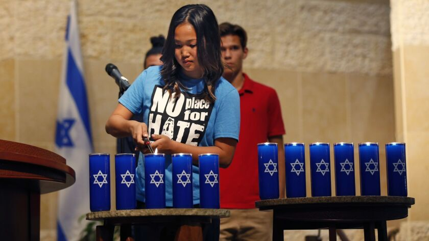 "Audrey Tu, 15, of the Anti-Defamation League's Delegates for National Youth Leadership participates in the Oct. 29 vigil for the Pittsburgh victims and the Jewish community at Congregation Beth Israel in University City. ""No Place for Hate"" is an ADL program for K-12 schools."