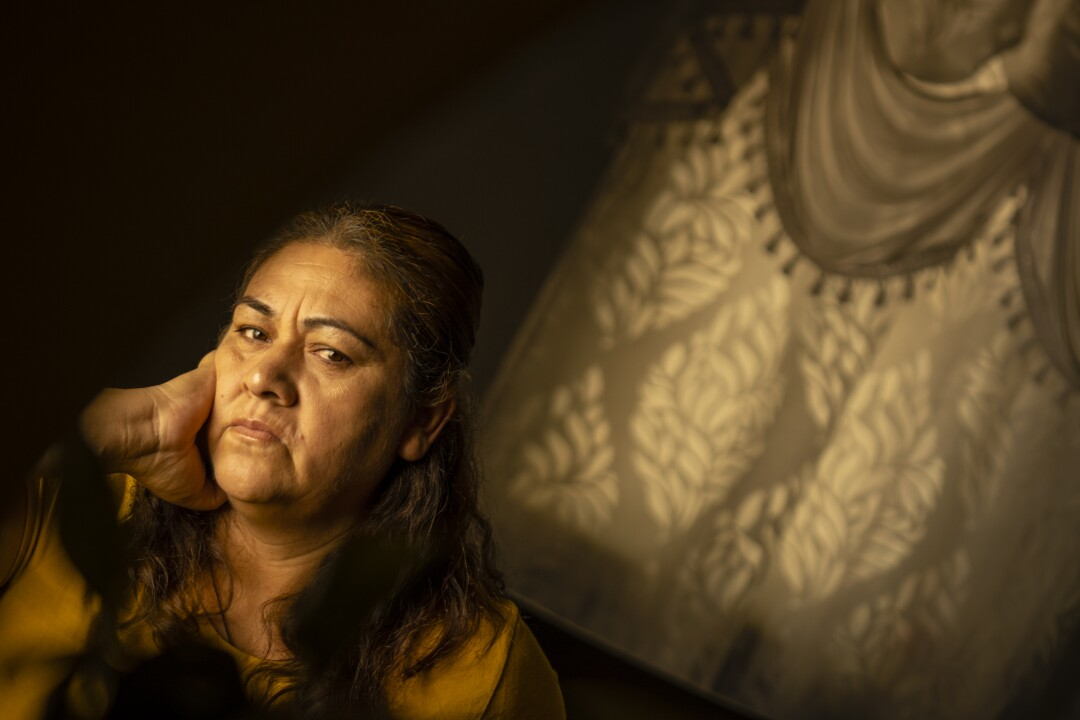 Maria Avila sits in her kitchen in Three Rocks.