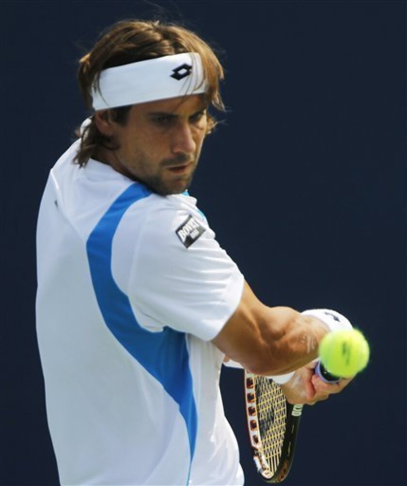 David Ferrer of Spain returns a shot to Florian Mayer of Germany during the U.S. Open tennis tournament in New York, Sunday, Sept. 4, 2011. (AP Photo/Mike Groll)