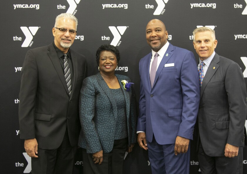 (Left to right) Michael Brunker, 2018 honoree; Dee Sanford, this year's Dr. Martin Luther King Jr. Human Dignity Award honoree; Tony Russell, chairman of the Jackie Robinson YMCA board of advisors; and Baron Herdelin-Doherty, president and CEO of the YMCA of San Diego County, at the 35th annual Dr. Martin Luther King Jr. Human Dignity Award Breakfast in Mission Valley on Friday, Jan. 17, 2020.