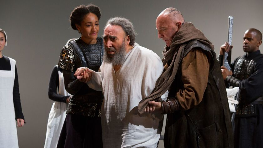 Lear (Antony Sher), flanked by Cordelia (Natalie Simpson) and the Earl of Kent (Antony Byrne).