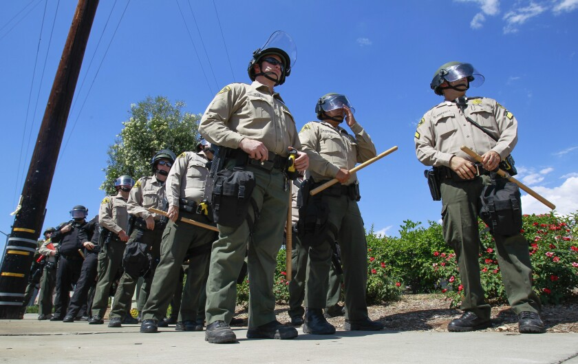 In this file photo, sheriff's deputies stage on Broadway in preparation for a protest.