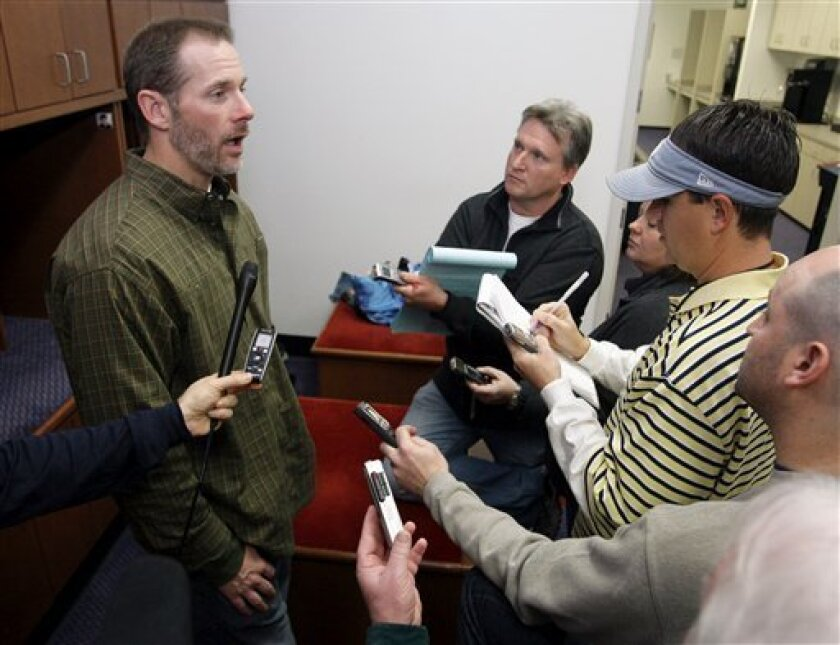 Tennessee Titans quarterback Kerry Collins, left, talks with reporters as players clean out their lockers in Nashville, Tenn., Monday, Jan. 12, 2009. The Titans' season ended with a 13-10 loss to the Baltimore Ravens in an NFL divisional playoff football game Saturday. (AP Photo/Mark Humphrey)