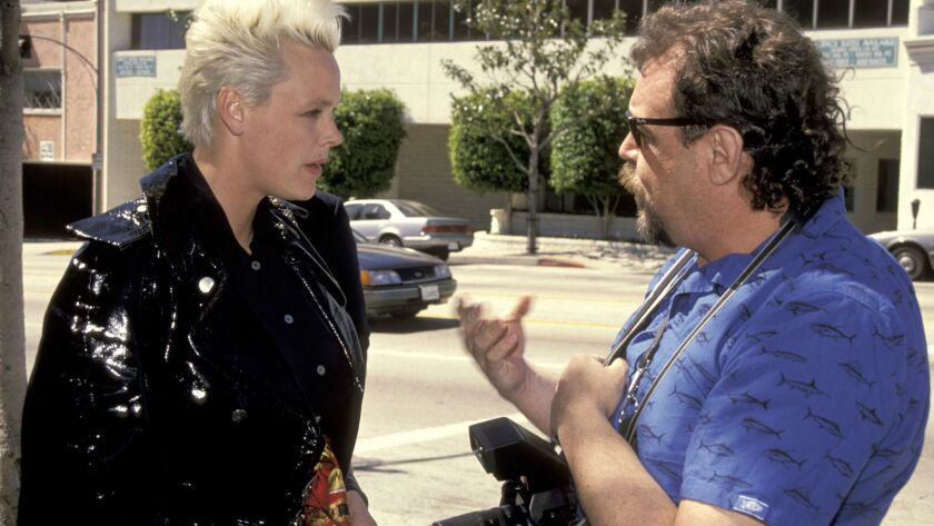 Actress and model Brigitte Nielsen and E.L. Woody exchange pleasantries outside Le Dome Restaurant,