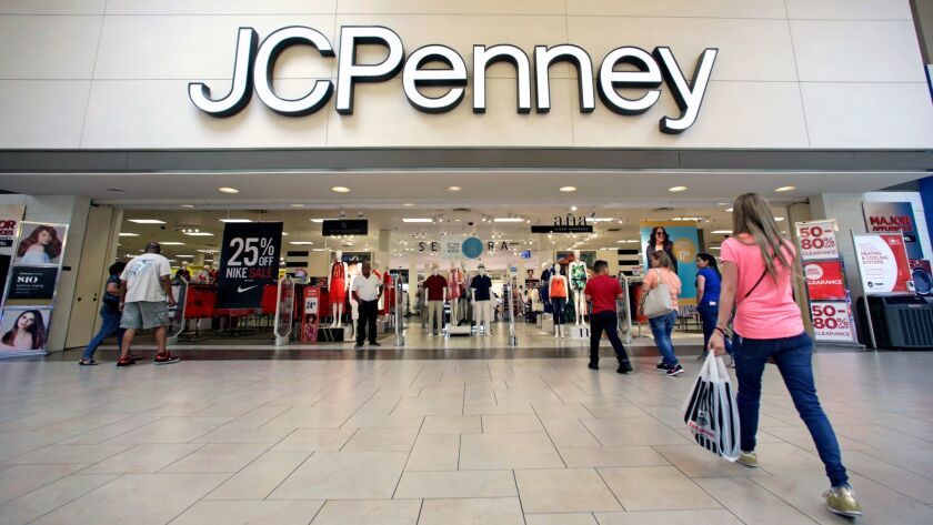 Shoppers walk into a J.C. Penney in Hialeah, Fla., on June 7