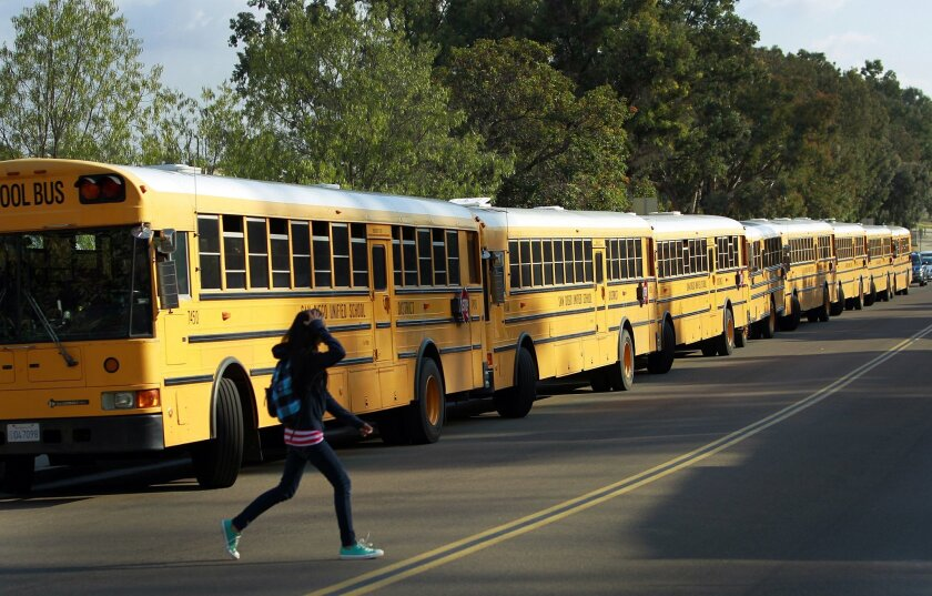 Buses line up at the San Diego School of Creative and Performing Arts in 2011. U-T file photo