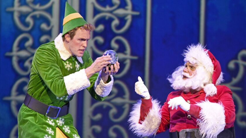 "Matt Owen, left, as Buddy and Bryan Dobson as Santa in Musical Theatre West's ""Elf"" in Long Beach."
