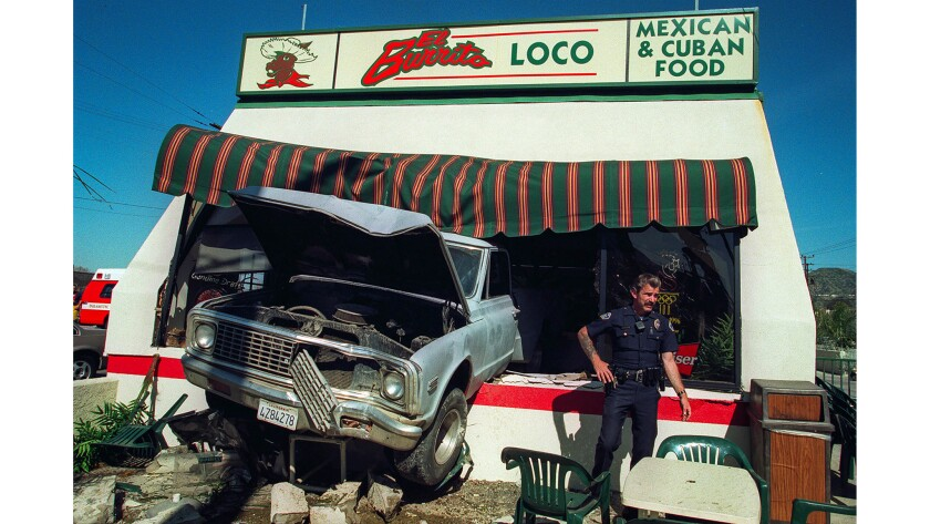 March 5, 1997: Over the Counter: A runaway truck straddles a counter at El Burrito Loco on Wednesday