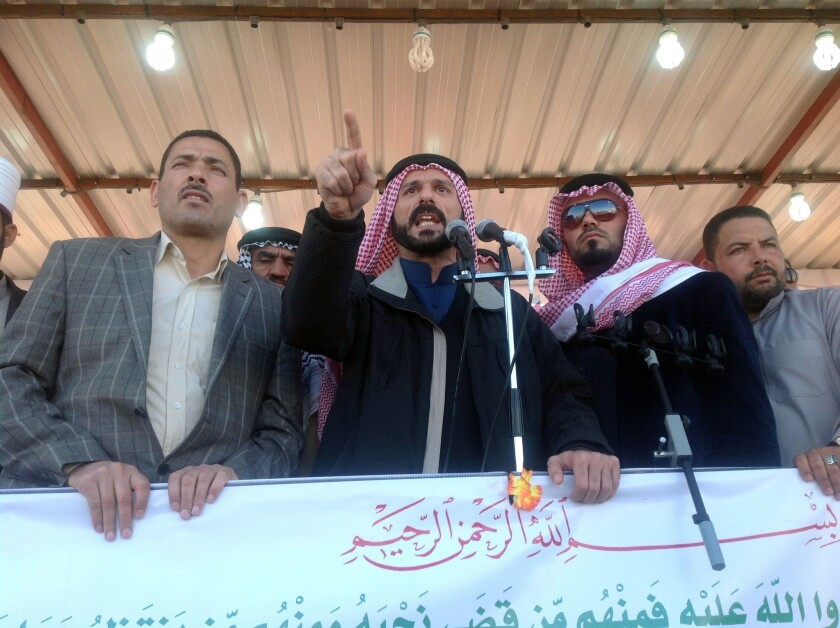 """Sheik Ali Hatem Suleiman speaks to a crowd in February. """"The Iraqi government is trying to get any excuse to attack Anbar,"""" he says."""