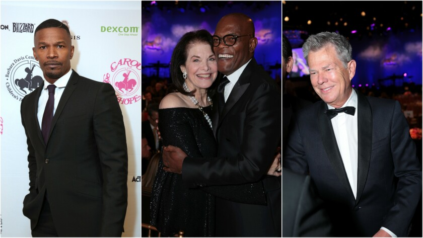 Jamie Foxx, left, gala honoree Sherry Lansing and Samuel L. Jackson, and gala honoree David Foster attend the Carousel of Hope Ball on Oct. 8.