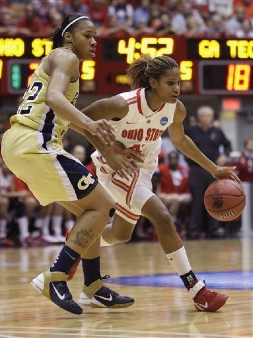 Ohio State's Brittany Johnson, right, drives to the basket against Georgia Tech's Alex Montgomery during the first half of a second-round NCAA women's college basketball tournament game Monday, March 21, 2011, in Columbus, Ohio. (AP Photo/Jay LaPrete)
