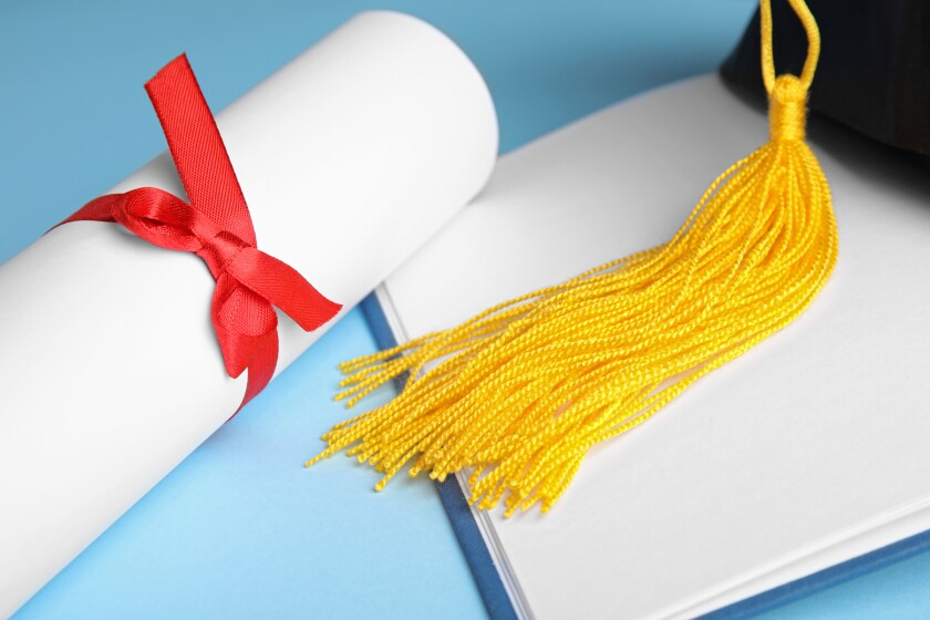 Graduation hat, open book and student's diploma on light blue background, closeup