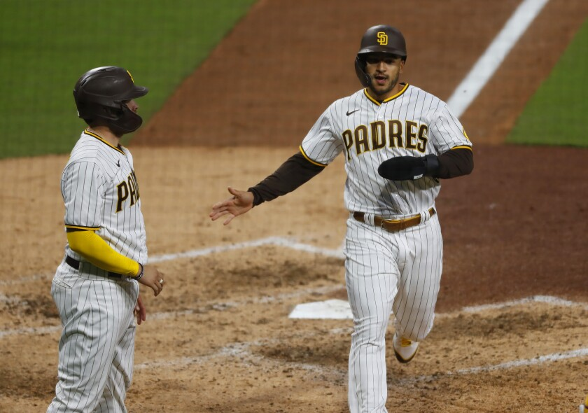 The Padres' Victor Caratini, left, and Trent Grisham