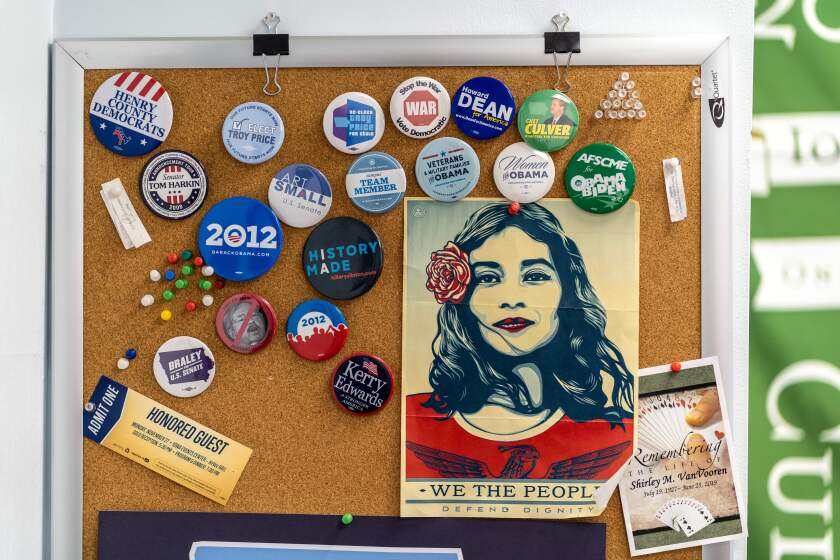 A collection of pins from different campaigns at Iowa Democratic Party Chairman Troy Price's office in Des Moines.