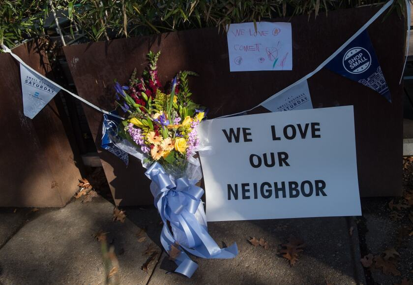 Flowers and signs adorn the front of a Washington restaurant targeted Sunday by a gunman who told police he was responding to unfounded rumors about a child sex ring.