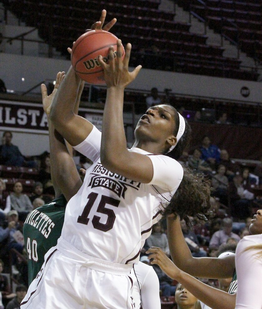 Mississippi State center Teaira McCowan (15) rebounds against Mississippi Valley State's Feleshia Walters (40) during the first half of an NCAA college basketball game in Starkville, Miss., Tuesday, Nov. 24, 2015. (AP Photo/Jim Lytle)