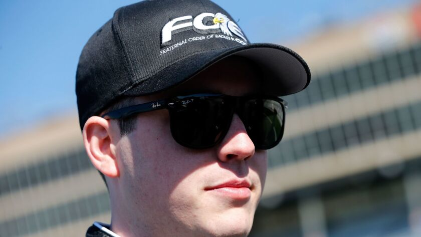 HAMPTON, GA - MARCH 04: Alex Bowman, driver of the #24 Fraternal Order of Eagles Chevrolet, stands
