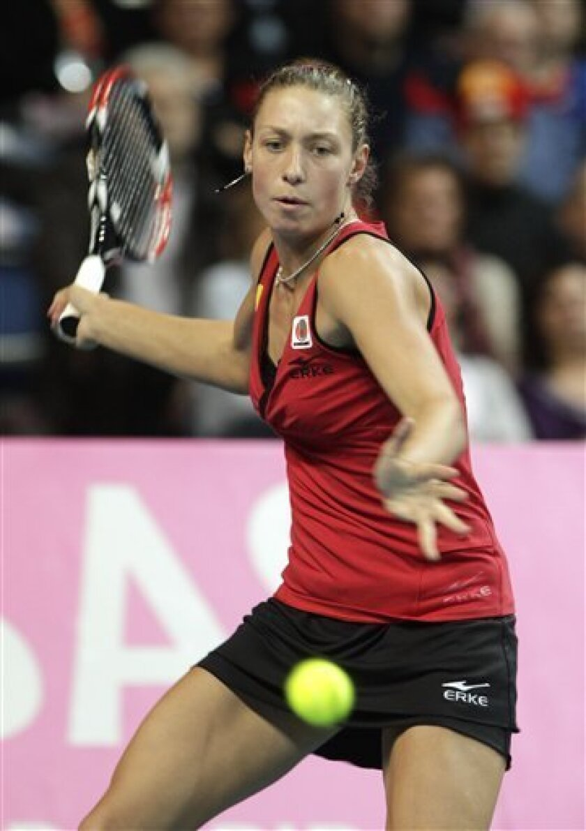 Belgium's Yanina Wickmayer returns the ball to US player Bethanie Mattek-Sands, during the World Group Fed Cup match in Antwerp, Belgium, Saturday, Feb. 5, 2011. (AP Photo/Yves Logghe)