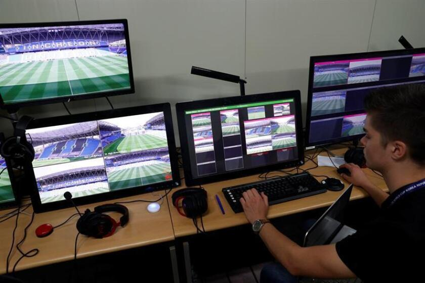 Staff work at the Video Assistant Referee (VAR) room. EFE/EPA/FILE