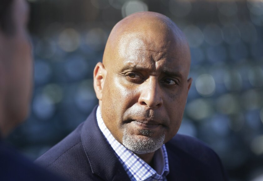 """FILE - In this March 17, 2015, file photo, Tony Clark, executive director of the baseball players' union, talks to reporters before a spring training baseball game between the Detroit Tigers and the Washington Nationals in Lakeland, Fla. Major League Baseball can suspend players with pay when legal charges are pending in """"exceptional cases"""" under a new domestic violence policy signed Friday, Aug. 21, 2015. """"Players are husbands, fathers, sons and boyfriends. And as such want to set an example that makes clear that there is no place for domestic abuse in our society,"""" Clark said in a news release. (AP Photo/Carlos Osorio, File)"""