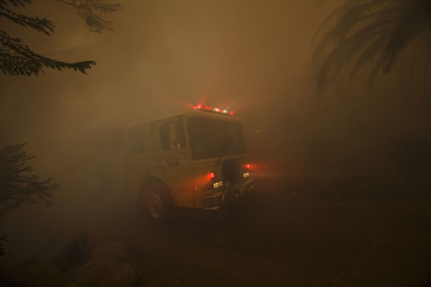 A firetruck near homes on East Mountain Drive in Montecito.