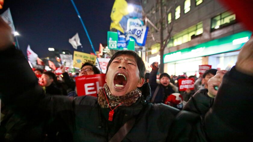 South Koreans opposed to President Park Geun-hye rally near the constitutional court in Seoul on Thursday. On Friday, she was ousted from office.