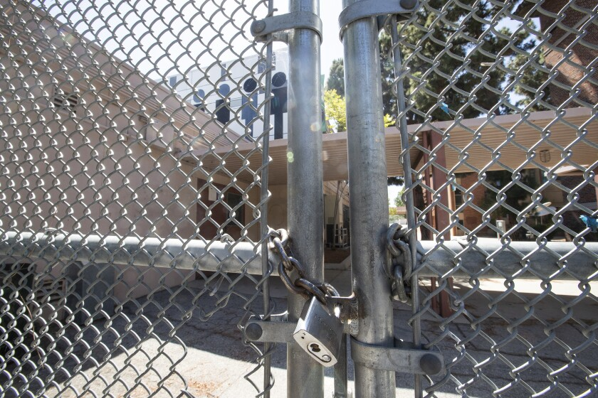 A locked gate in front of Hamilton High School on Robertson Blvd in Los Angeles.