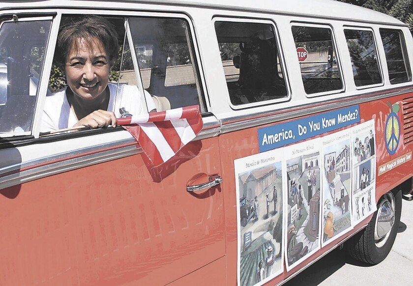 Sandra Robbie, shown here in 2007, in her 1967 Volkswagen van at her home in Santa Ana. Robbie drove the bus across the country to educate people about Sylvia Mendez and Civil Rights.