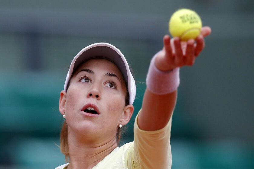 Spain's Garbine Muguruza serves the ball to Australia's Samantha Stosur during their semifinal match of the French Open tennis tournament at the Roland Garros stadium, Friday, June 3, 2016 in Paris.  (AP Photo/Michel Euler)