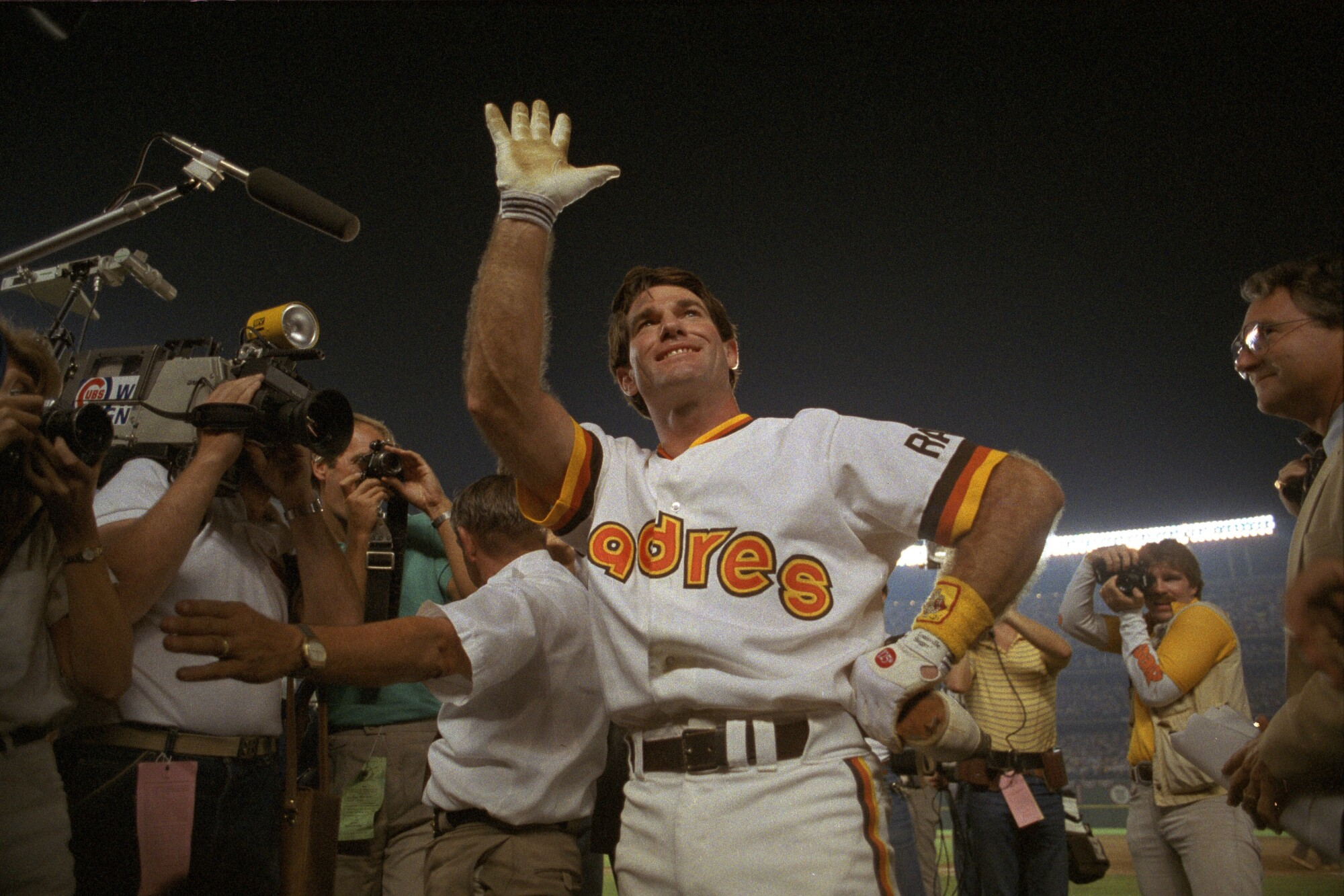Steve Garvey waves while sporting the Padres' uniform from 1984, when they went to the World Series.