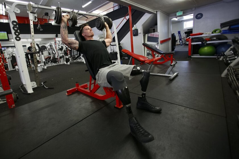 Marine veteran Chris Van Etten of San Diego, seen working out Wednesday at Fitness101 gym in La Mesa, lost both his legs while serving in Afghanistan in 2012. The 25-year-old model and college student is now the centerpiece of a new national underwear campaign by Jockey International.