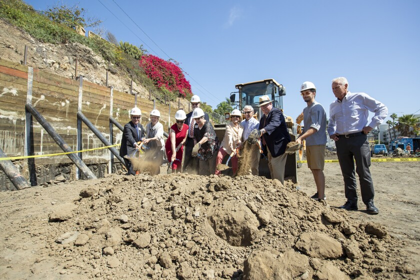 College officials and other dignitaries break ground Monday for Orange Coast College's new Professional Mariner Training Center in Newport Beach.