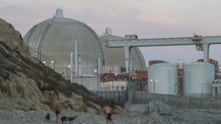 A couple relaxes on the beach next to the San Onofre Nuclear Generating Station earlier this month.