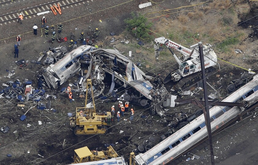 In this aerial photo, emergency personnel work at the scene of a deadly train wreck on May 13 in Philadelphia.