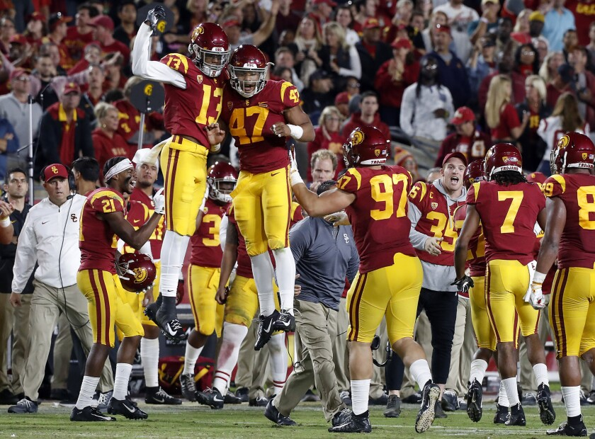 The USC sideline celebrates after the Trojans defense forced Colorado to turn the ball over on Oct. 13.