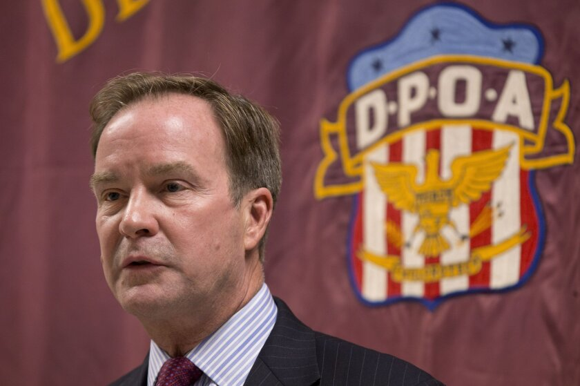FILE - In this Sept. 10, 2014 file photo, Attorney General Bill Schuette speaks at the Detroit Police Officers Association in Detroit. Michigan's attorney general Schuette will announce criminal charges Wednesday, April 20, 2016, against two state regulators and a Flint employee, alleging wrongdoin