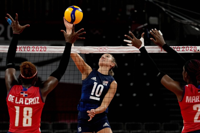United States' Jordan Larson hits the ball during the women's volleyball quarterfinal match between Dominican Republic and United States at the 2020 Summer Olympics, Wednesday, Aug. 4, 2021, in Tokyo, Japan. (AP Photo/Frank Augstein)