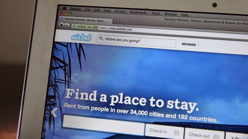 The Airbnb website is displayed on a laptop on April 21, 2014.