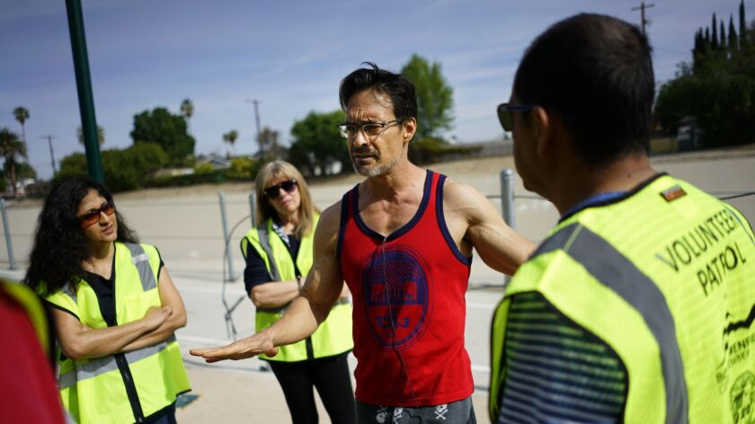 David Spangler, center, talks with volunteers at the West Valley Los Angeles River Bikeway on March 31.