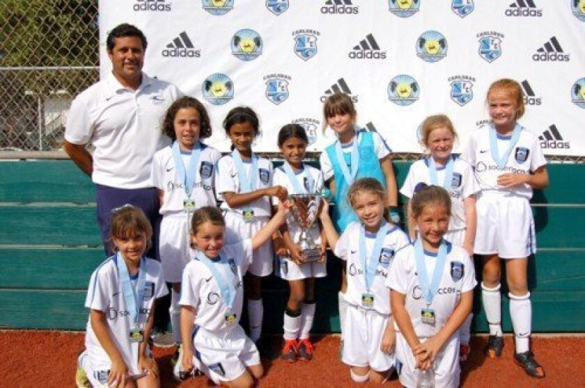 Back row: Coach Ruben Martinez, Anna Nichols, Kira Roy, Alisha Wadhwa, Juliana Caldarelli, Grace Feron, Madison Simpson; front row: Kayley Dorfman, Mia Hull, Taylor Edwards, Claire Curran
