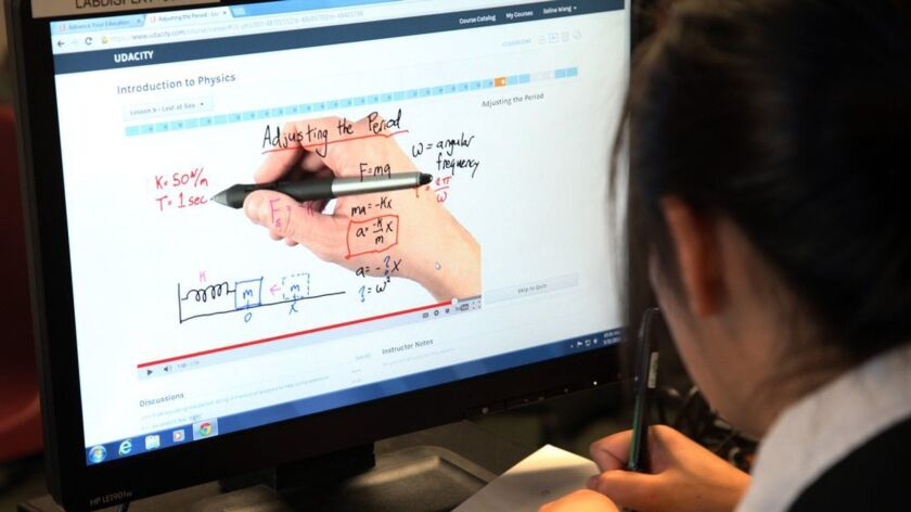 A student takes an online course offered by San Jose State and Udacity, an online education start-up.