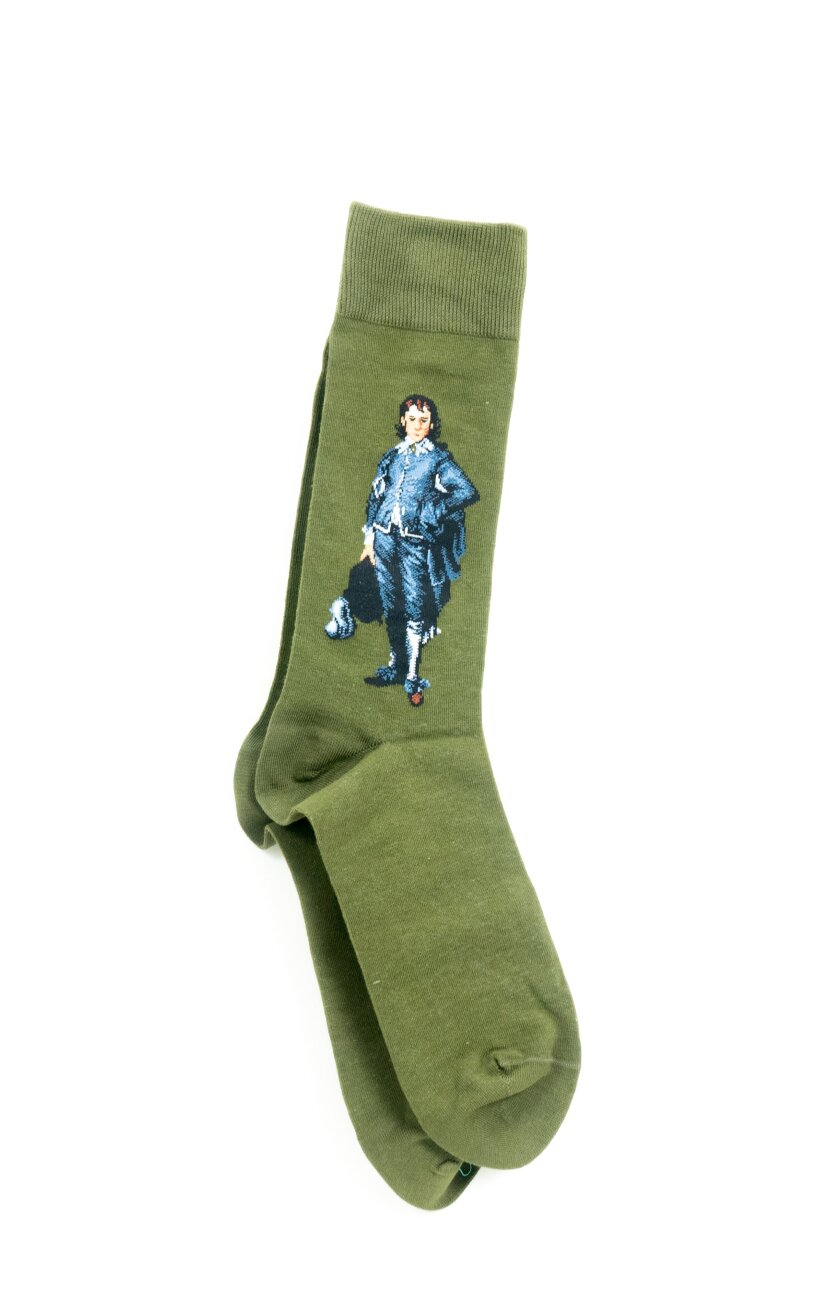 Green socks bearing the image of a man dressed in blue.