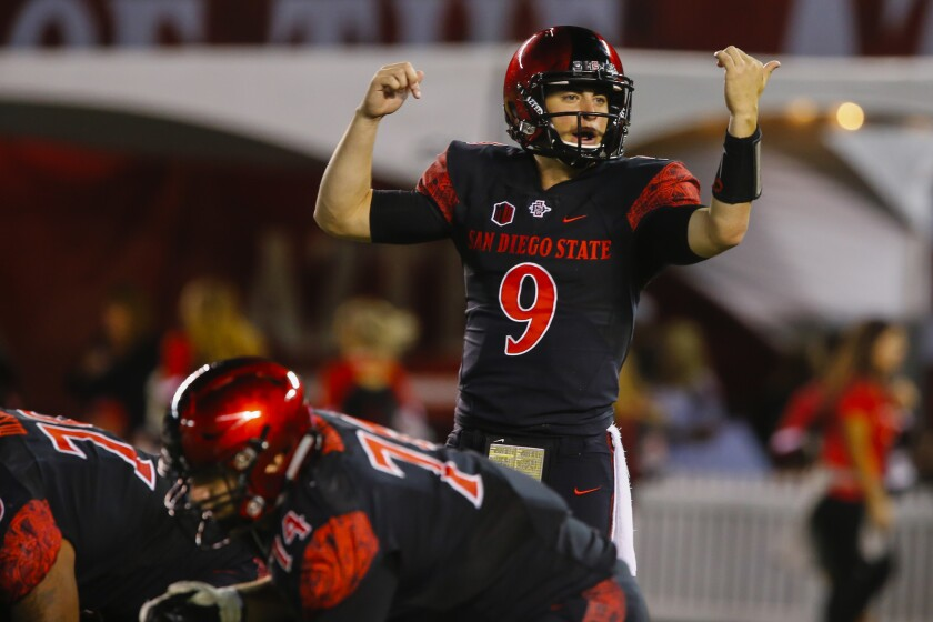 SDSU quarterback Ryan Agnew (9) motions before a play in the first quarter against Air Force.